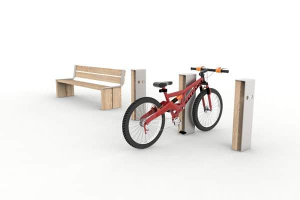 Trois bornes vélo NUT, sur l'une d'entre elles un vélo accroché ; à gauche, un banc 3 places NUT