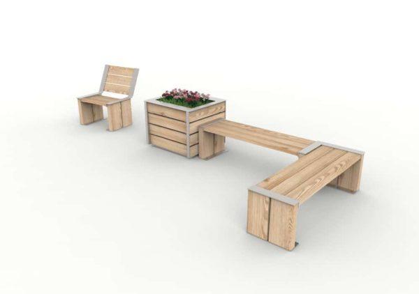 Un fauteuil NUT à côté d'une jardinière NUT avec des fleurs, accolées à deux banquettes NUT qui font un angle droit