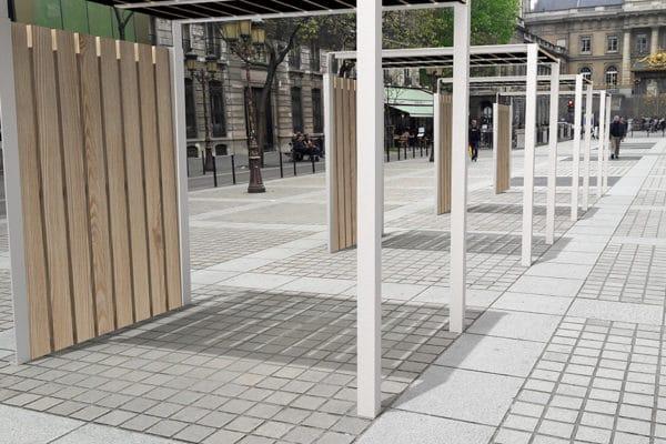 Quatre galeries couvertes NUT incrustées sur des pavés en pierre sur une place en ville