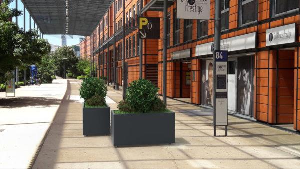 Insertion 3D de deux jardinières rectangulaires CUB grises dans un environnement réel, ici à l'extérieur d'un centre commercial